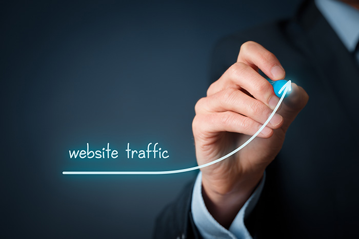 Website traffic improvement concept. Businessman draw increasing graph with text website traffic.